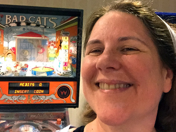 Laurie in front of pinball machine - Bad Cats