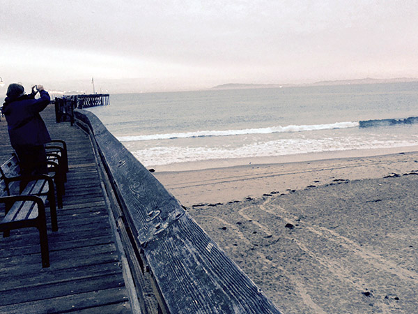 Mark on the pier. Waves are seen against the shoreline