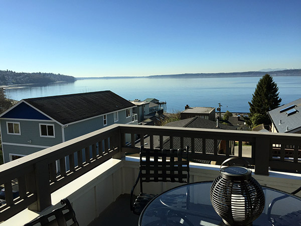 Beautiful view of a blue sunny day across the Puget Sound from a roof deck