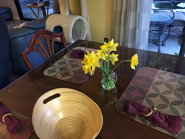 Mahogany dining table with daffodil bouquet
