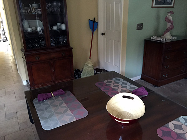 View of clean table with broom in the corner