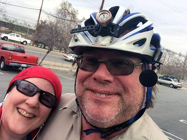 Laurie and Mark in bike gear - Mark has a scruffy beard.