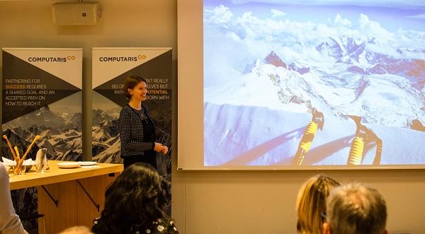 Raluca Rusu, CEO, speaking at the opening of Computaris Suisse in Bern, Switzerland