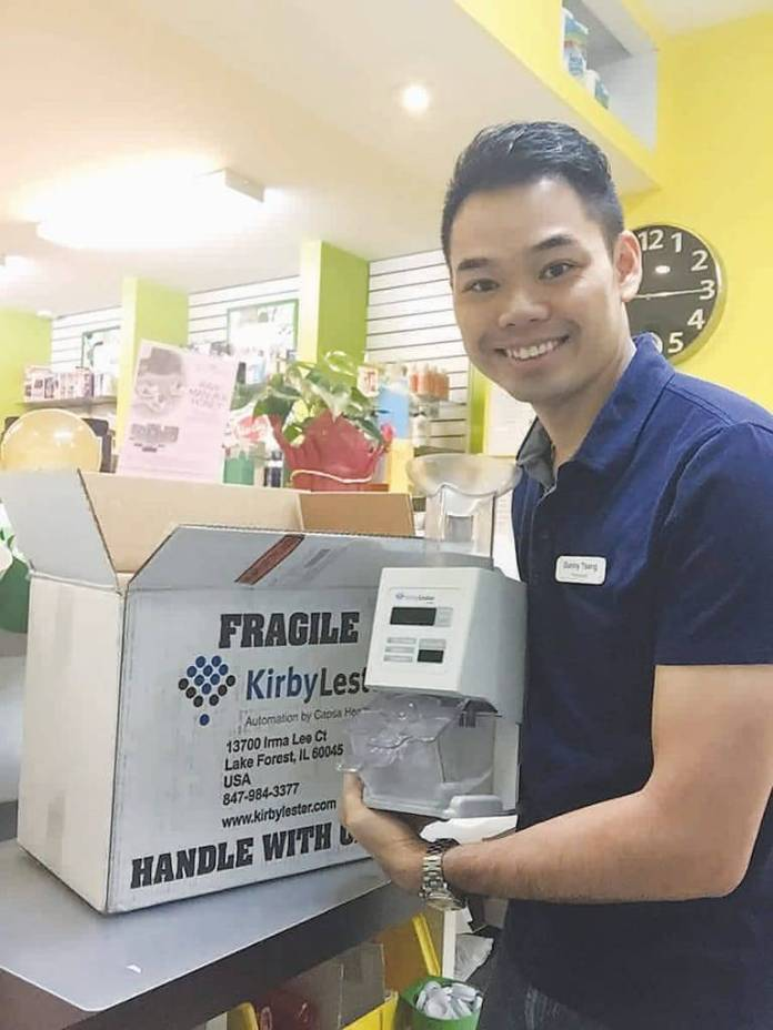 Danny Tsang unwraps his new Kirby Lester KL1 counter at Accurate Pharmacy in Brooklyn, N.Y.