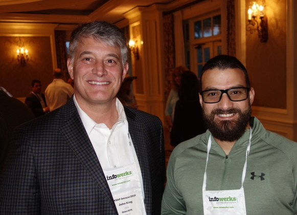 John King from OmniSYS, left, and Luis Marquez from Leon Medical Centers.