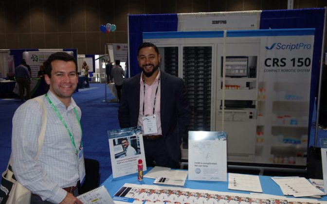 National Community Pharmacists Association 2019 Conference and Trade Show Exhibits Corey Edwards, left, from Health Data Wise with ScriptPro's Nick Ruiz.