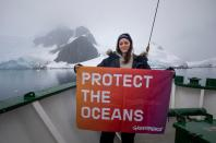 Actor Marion Cotillard holds a banner reading: 'Protect The Oceans' onboard the Arctic Sunrise in Paradise Harbour, Antarctica. Greenpeace is back in the Antarctic on the last stage of the Pole to Pole Expedition. We have teamed up with a group of scientists to investigate and document the impacts the climate crisis is already having in this area. *This picture was taken in 2020 during the Antarctic leg of the Pole to Pole expedition under the Dutch permit number RWS-2019/40813.