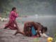 Women pray on the shores of lake Chicabal. Photo: Santiago Billy/Comvite