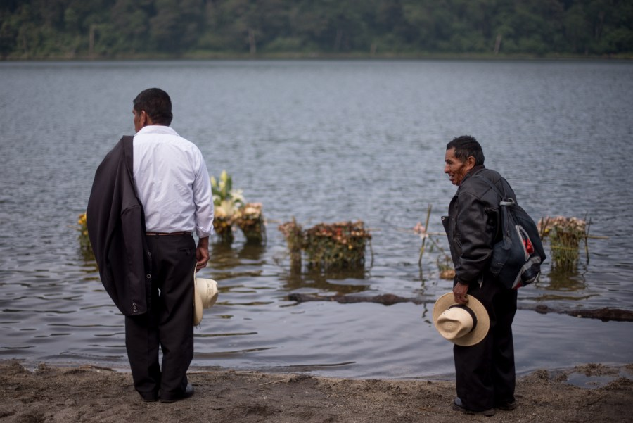 Two men pay their respects to the lake, Chicabal. Photo: Santiago Billy/Chicabal
