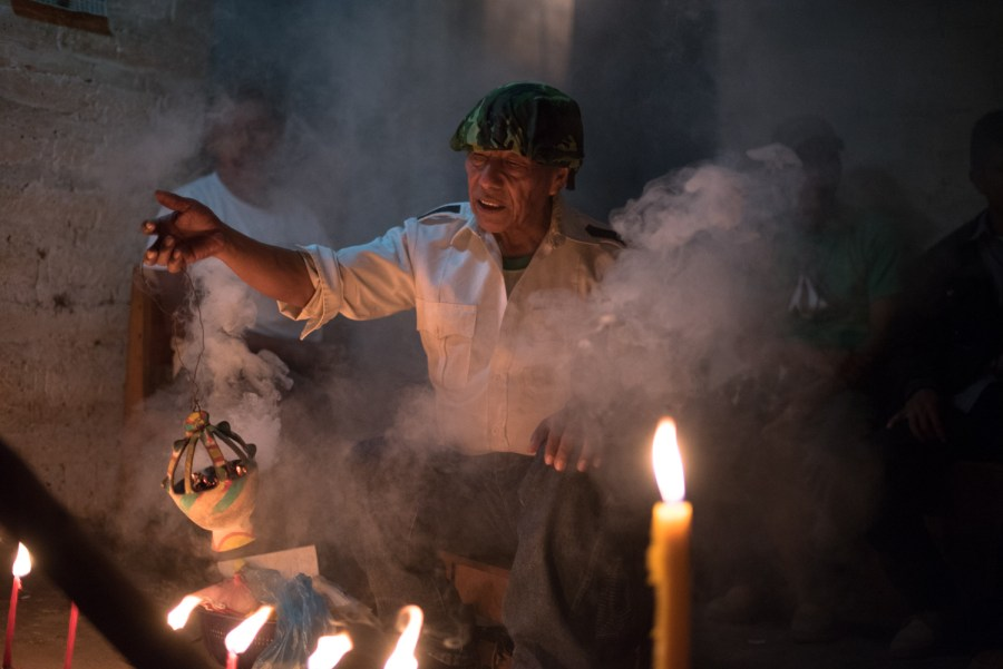 "Juan Pablo Camayá moves incense during the ""vigil of the masks"" prior to El Palo Volador, the dance of Angels and Monkeys. Photo: Santiago Billy/Comvite"