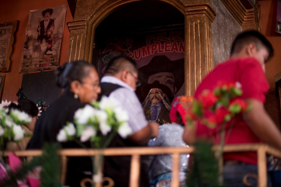 "The main San Simón in the temple with a printe poster wishing ""happy birthday"". Photo: Santiago Billy/Comvite"
