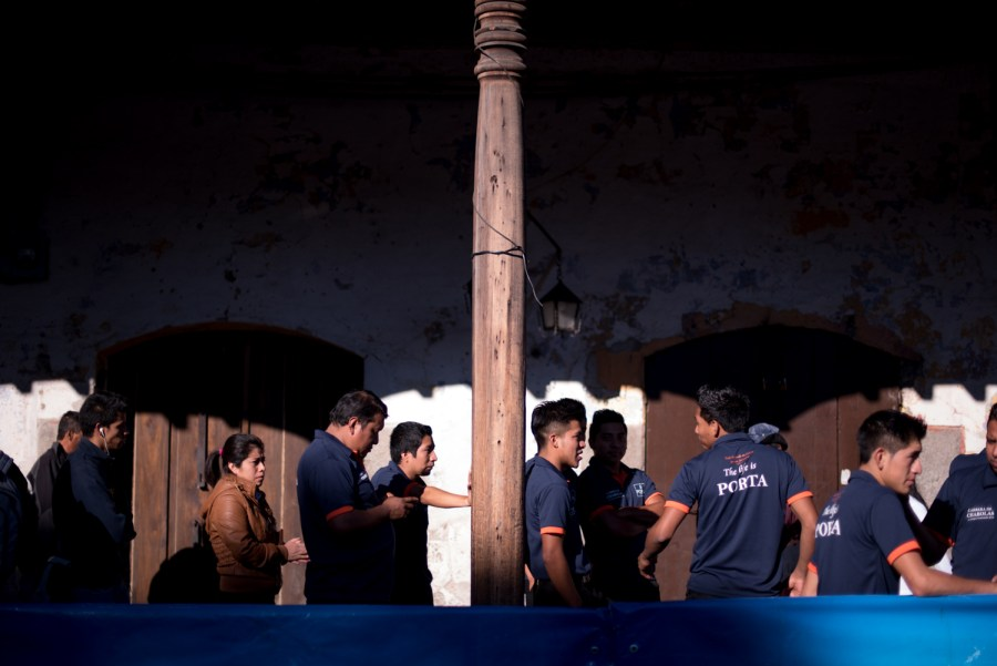 Runners wait to get their special racing gear for the Tray Race in La Antigua Guatemala. Photo: Santiago Billy/Comvite