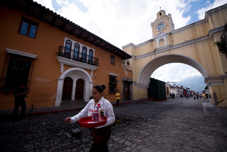 A runner passes by the Arch of Santa Clara in La Antigua Guatemala. Photo: Santiago Billy/Comvite