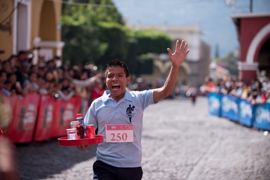 The winner of the race Rudy Civil as he finishes the Race of Trays in La Antigua Guatemala. Photo: Santiago Billy/Comvite