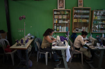 Women work preparing the cucurucho tunis and other small work in a small workshop in La Antigua Guatemala. Photo: Santiago Billy/Comvite