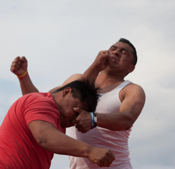 Two fighters trade punches in Chivarrerto's ring. Photo: Jeff Abbott/Comvite