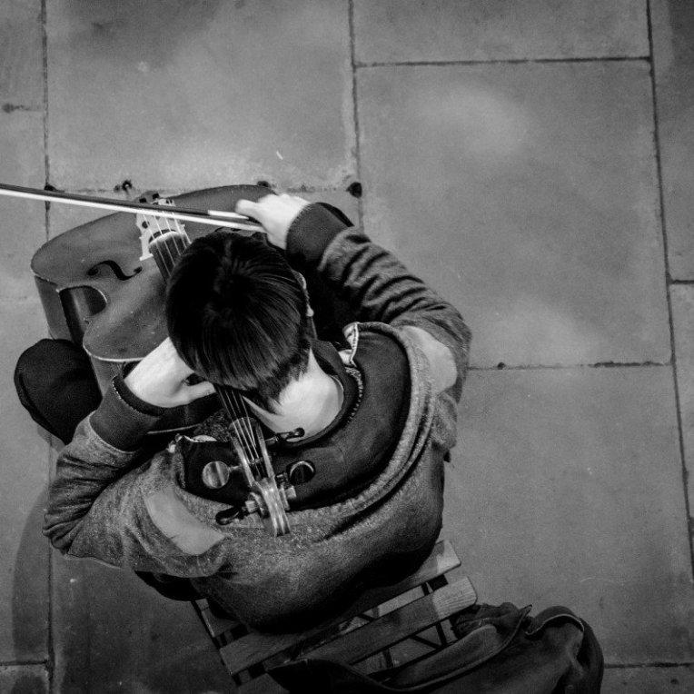cello player street busker