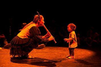 child-listen-flute-min