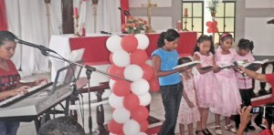 Young musicians sing the Lord's praises.