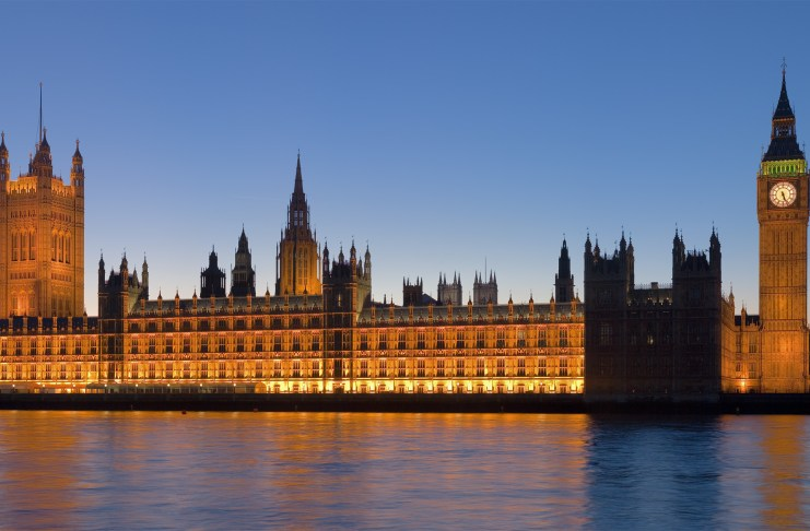 UK Houses of Parliament lit up at night.