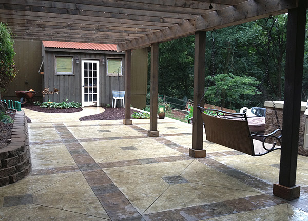 Evergrain Deck With White Vinyl Railing Stone Walls Stamped Concrete W Steps And