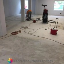 removing carpet adhesive by concrete grinding