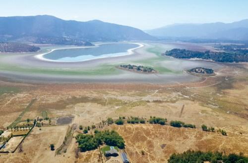 Laguna de Aculeo: Klimawandel und eine Übernutzung der Wasserressourcen führten am 9. Mai 2018 zur kompletten Austrocknung.