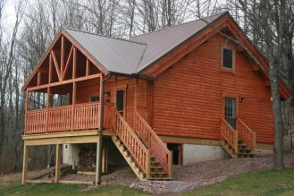 Log home view with porch