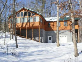 log home on foundation in the snow