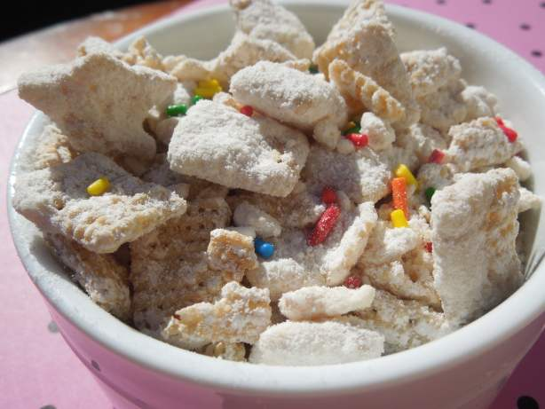 cake batter puppy chow in a white bowl