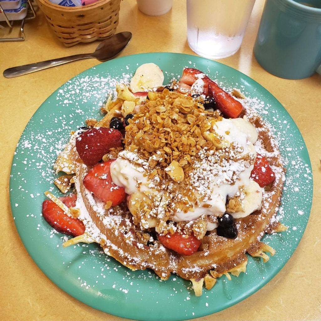 Healthy Start Waffle with Strawberries, Bananas, Blueberries and Granola at Real Food Cafe