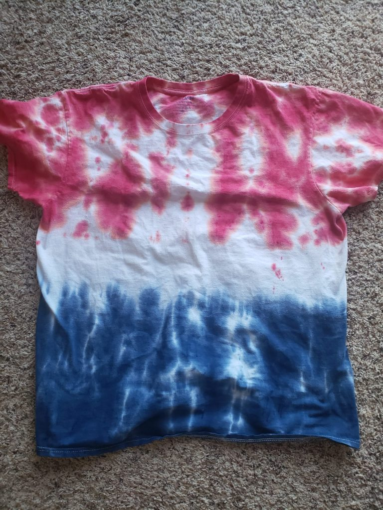 Finished tie-dye t-shirt with red white and blue design