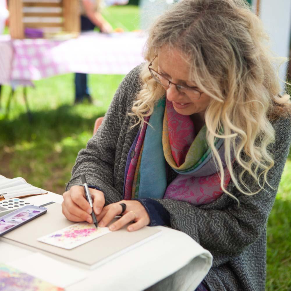 Artist Hayley Reynolds in The Confetti Flower Field 2019