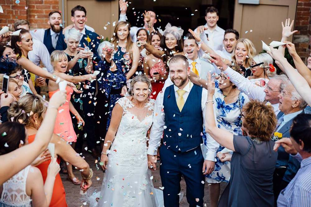 A circle of confetti around the happy couple - Candy Coloured Rose Petals