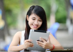 Asian woman on iPad