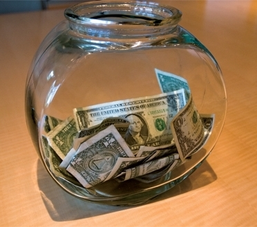 Dollar bills in a fishbowl