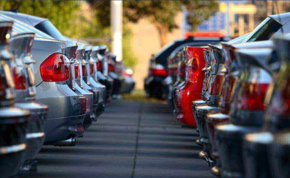 Rows of vehicles line the image with the boots in view either side.