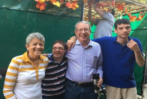 Suzanne, Jason and Steven Baker share a laugh with Max Steinberg outside the sukkah.