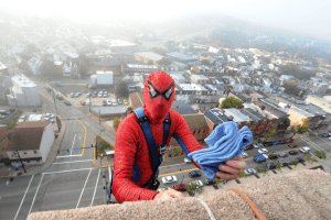 Rick Bollinger, dressed as Spiderman, scales the side of Children's Hospital of Pittsburgh of UPMC on Wednesday. Mr. Bollinger works for Allegheny Window Washing, which was employed by the Lawrenceville hospital. - Photo Credit Nate Guidry/Post-Gazette