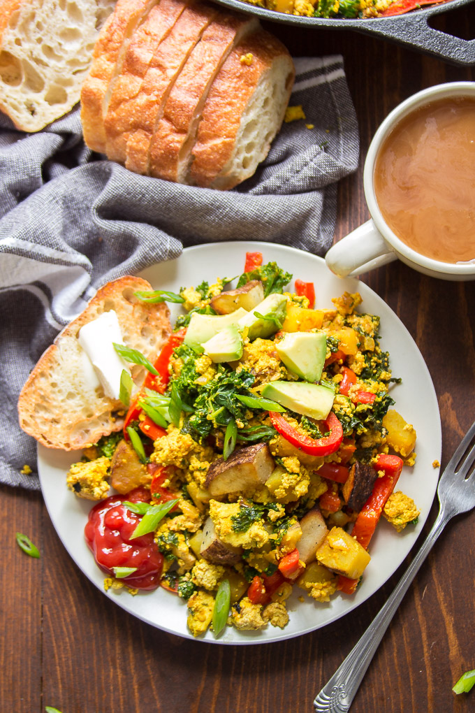 Plate of Tofu Scramble with Napkin, Bread and Coffee Cup
