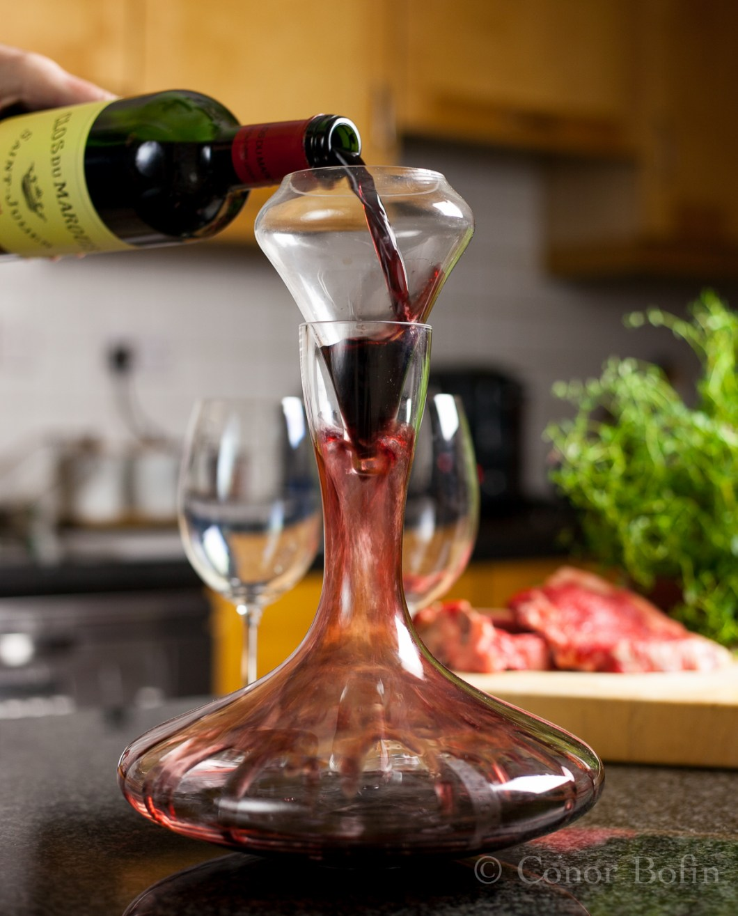 The Clos du Marquis 2004 is poured through an aerator into the decanter.