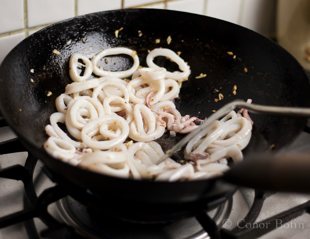The floppy squid rings go all circular when they start to cook.