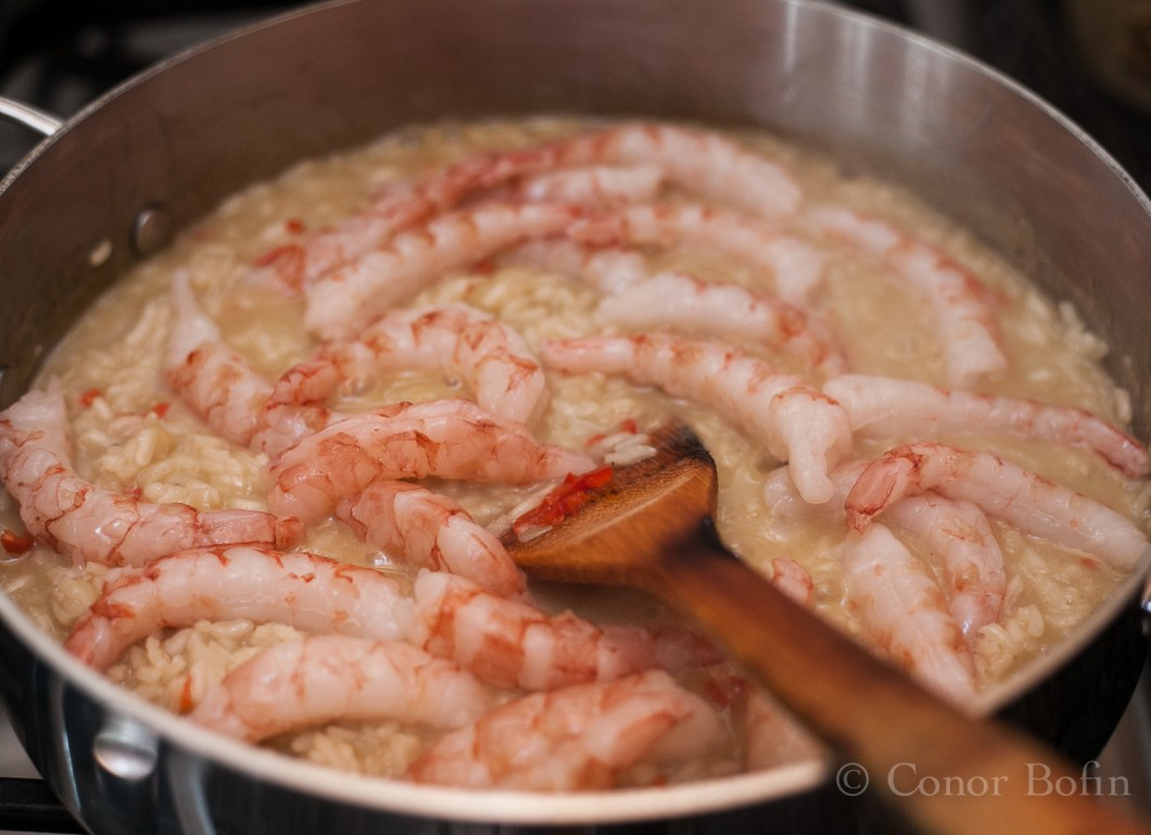 At just the right moment, add in the prawns and stir. You have to work the right moment out for yourself.