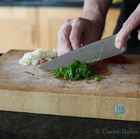 Garlic chopped. I give the same treatment to the parsley and the chili.