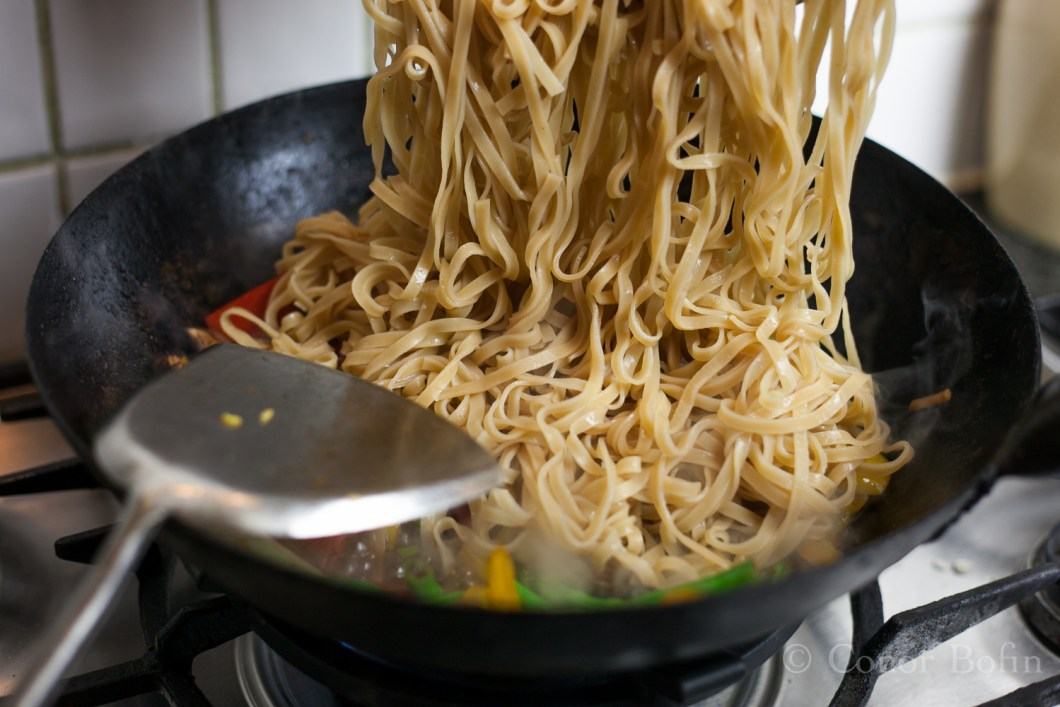 That will make a man of you. Stir those noodles until everything is combined.