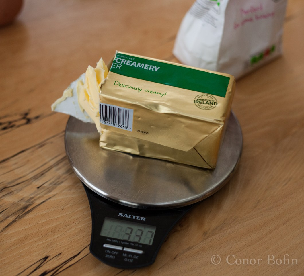 The butter will weigh less without the foil.