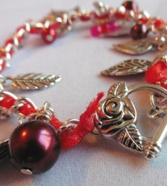 Red Ribbon Leaf Charm Bracelet with Red Glass Pearls and Beads