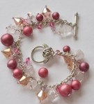 Charm Bracelet with Rose Clasp and Pink Beads and Glass Nuggets