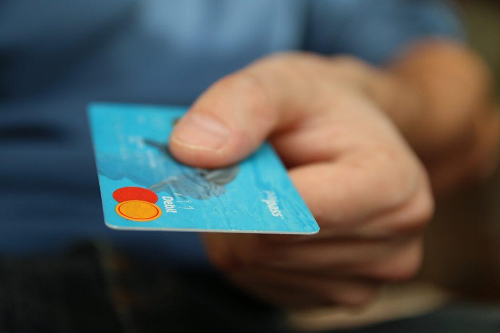 handing over a debit card