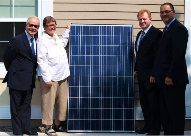 Paul Campbell, president of the Association of Professional Engineers and Geoscientists of New Brunswick, far left, with Lois Corbett, Executive Director of the Conservation Council of New Brunswick, left, with Minister of Environment Brian Kenny, right, and Minister of Energy and Mines Donald Arseneault at the launch of APEGNB's solar panel array in Fredericton, the largest solar installation in New Brunswick.